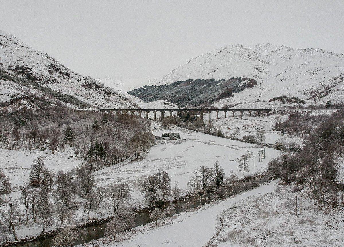 Glen-Finnan Bridge, Scotland Road Trip in Scottish Highlands in Winter Snow