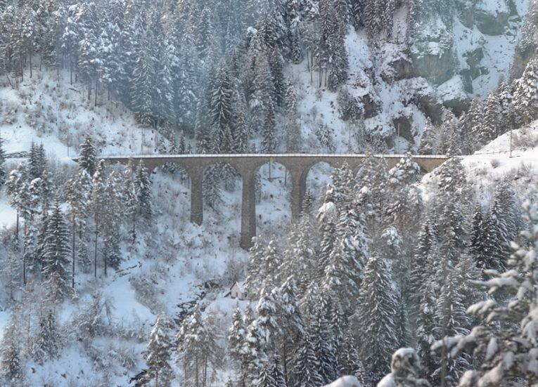 Landwasser Viaduct on Glacier Express, Interrail in Winter Train Travel in Europe