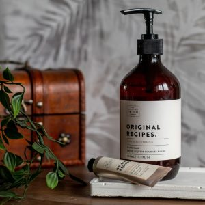 The Scottish Fine Soaps Company Buttermilk hand wash and hand cream on concrete tray with wooden box in back