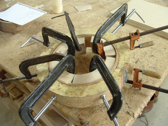 Banjo rim forming. Gluing the first and second laminations together.