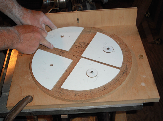 A pivoting jig used for drilling shoe bolt holes.