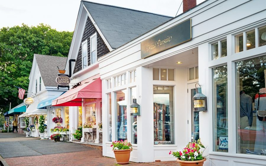 Business income insurance, a row of colorful storefronts in Cape Cod, MA.