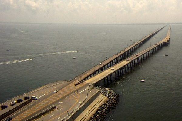 Eastern Shore of Virginia, Chesapeake Bay Bridge Tunnel, aerial view of two bridges merging into a single stone and concrete island at the beginning of the tunnel.
