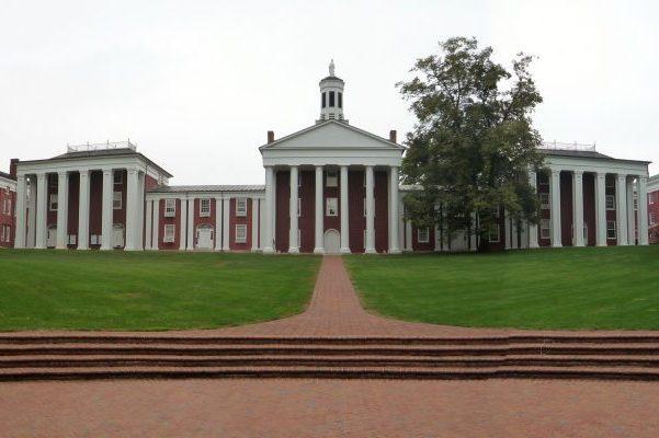 Lexington, VA Washington and Lee University panoramic view of large brick buildings with imposing white columns adjoining matching brick walks across lush green lawns.