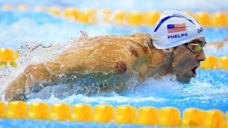 RIO DE JANEIRO, BRAZIL - AUGUST 08: Michael Phelps of the USA competes in the Men's 200m Butterfly Heats on Day 3 of the Rio 2016 Olympic Games at the Olympic Aquatics Stadium on August 8, 2016 in Rio de Janerio, Brazil. (Photo by Vaughn Ridley/Getty Images)