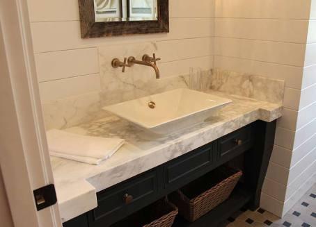 A light granite countertop in a bathroom.