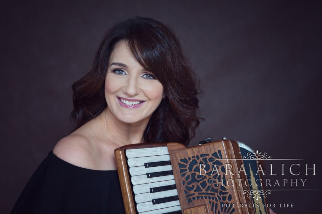 Professional headshot of musician with accordion by a Portrait Photographer in Waterford Bara Alich Photography