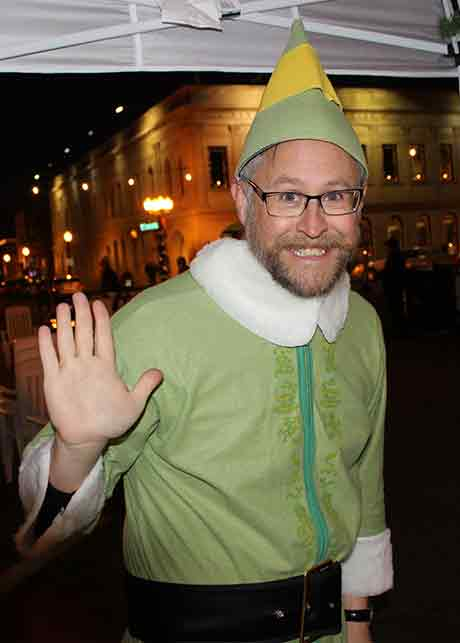 Executive Director Waves While Dressed As Buddy The Elf