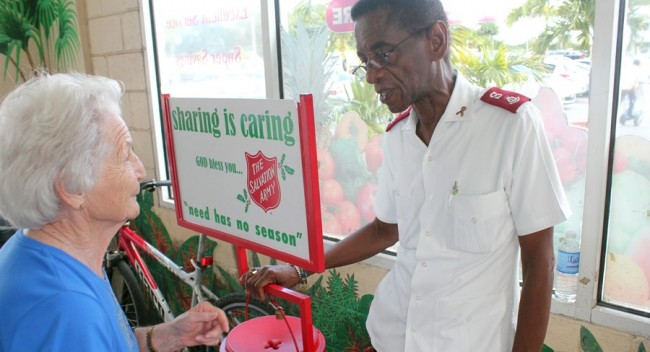 Salvation Army officer thanking this lady for her donation today.