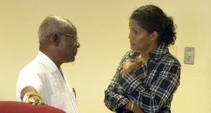 Trade Union veteran Sir Roy Trotman chats with Minister of Labour Esther Byer-Suckoo. (File photo)