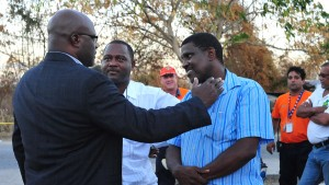 Attorney General offers comfort to Paul Bynoe, while cabinet collegue Donville Inniss looks on.