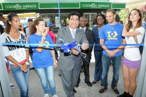 President of the Barbados Chamber of Commerce and Industry, Lalu Vaswani cuts the ribbon to officially open the new Converse store on Broad Street today.