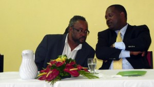 Minister of Industry, International Business, Commerce and Small Business Development, Donville Inniss (right) in discussion with Chief Executive Officer of the Pinelands Creative Workshop, Rodney Grant.