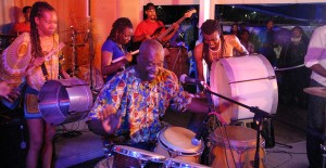 "DJ Hurricane, Wayne ""Poonka"" Willock and Lovell jamming on the drums."