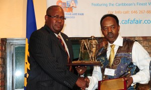 Consul General of Guyana to Barbados, Michael Brotherson (left), collected the Caribbean Luminary Award on behalf of the faåmily of the late Philip Moore. Executive Director of CaFA, Anderson Pilgrim (right), presented Mr. Brotherson with the award.