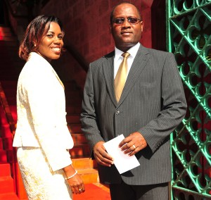 St. James South MP Donville Inniss and his wife Gail before heading up the stairs to Parliament.