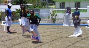 Green House's D'angelo Wilkinson-Jones leads and eventually wins the 25m sack race.