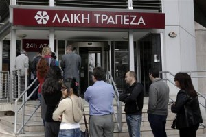 Cypriots line-up at ATM machine.