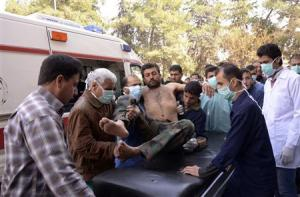 Attending to an injured man in Aleppo, Syria today.