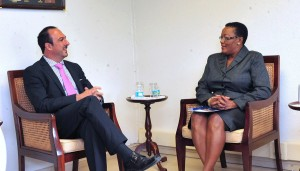 Minister Maxine McClean having a conversation with Ambassador Jorge Daccarett during his courtesy call.