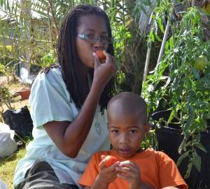 Lisa Browne and her son Imhotep Heru enjoying living tomatoes.