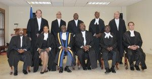 """The new men and woman of """"silk"""" pose with Chief justice Sir Marston Gibson (third left) and Attorney-General Adriel Brathwaite."""