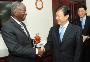 Prime Minister Freundel Stuart sharing a light moment with the People's Republic of China's Vice Minister of Commerce, Zhong Shan.