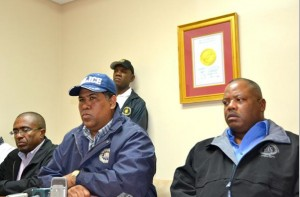 Bahamas top cop Ellison Greenslade (centre) speaking to the press.