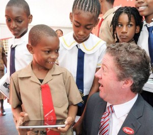 Dujan Brown (front left), of Rennock Lodge All-Age, holds a Huawei Tablet he collected on behalf of his school from Digicel Jamaica CEO Andy Thorburn (right), as other students look on.