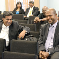 Harnarine and Carballo in friendly chat at CLICO enquiry.