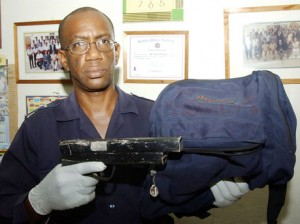 In this file photo, Inspector Lenox Harper holds a homemade shotgun that was taken from a 16-year-old schoolboy.