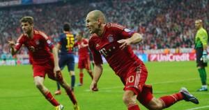Bayern Munich's Arjen Robben (right) celebrates his goal.