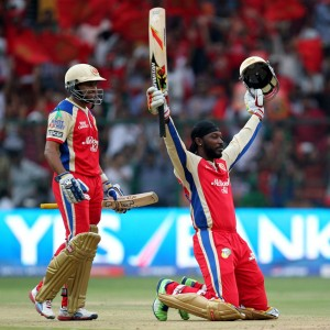Bangalore opener Tillakaratne Dilshan watches as team-mate Chris Gayle salutes supporters.