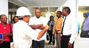 The Minister of Health and his team getting the details of the project.