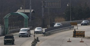 South Korean vehicles carrying South Korean employees working at the Kaesong Industrial Complex, head toward South Korea's Customs, Immigration and Quarantine from KIC, just south of the demilitarised zone separating the two Koreas, in Paju, north of Seoul, today.