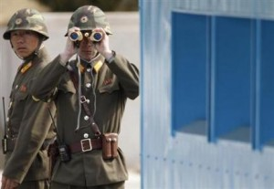 North Korean soldiers look along the border at the southern neighbours.