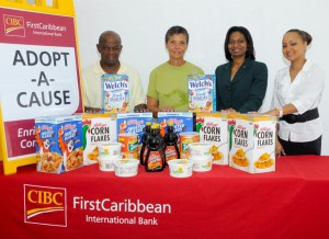 Tony Bourne (left) and Lynn Tempro (second left) of the feeding programme accept the donation from Rosslyn Alleyne (third left) and Ayesha Lett of CIBC FirstCaribbean.