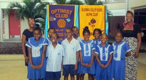 (Back left and right respectively) Club Advisors Pauline Walters and Camile Bennett. (Centre) Charter Secretary/Treasurer, Brandon Leonce and Charter President Kimani Archer, with members of the new club.