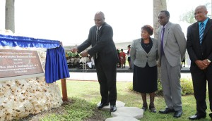 Minister of Home Affairs and Attorney General, Adriel Brathwaite (left), unveiling the plaque as Permanent Secretary in the Ministry of Home Affairs, Lucine Wharton Issacs and Principal of the GIS, Erwin Leacock and Deputy Principal Ronald Brathwaite look on.