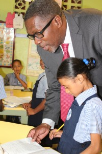 Senator Husbands going over lessons with Infants B student Renitta Toney.