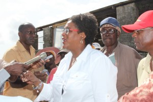 Opposition Leader Mia Mottley speaking with reporters at Fisherpond Plantation today.