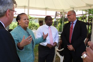 Museum Director Alissandra Cummins gesticulates as she makes a point to CIBC/FirstCaribbean CEO Rik Parkhill (left), Deputy Director Kevin Farmer (second right) and CIBC/ FirstCaribbean Managing Director Mark St. Hill (right).