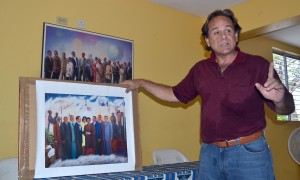 Raul Garcia shows off his 2010 NIFCA Silver Award painting of civil rights leaders and black freedom fighters.