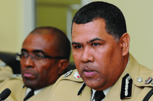 Police Commissioner Ellison Greenslade (right).