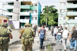 FLASHBACK: Security forces and members of the press in Tivoli Gardens in 2010.