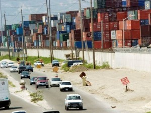 Containers at the Kingston Wharf. A customs officer, was fined $700,000 for one count of illicit enrichment.