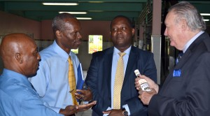 Minister Inniss (second from right) and officials of his ministry listen to Sir David talk rum.