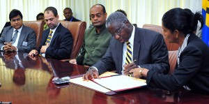 PM Stuart signs Protocol VI.