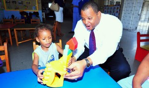 "There can be no doubt that one of the toughest, and perhaps ""least thankful"", jobs in Barbados today must be that held by MP Chris Sinckler — Minister of Finance. Today, when he dropped in on the John Beckles Day Nursery open house and sat to build this toy house with Riquelme Green it must have been most comforting to know there was no Opposition Leader or Down to Brass Tacks ""regular"" to tell him he is doing it wrong. And it appears that the minister enjoyed the break and the toddler the company."