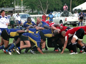 Bruising rugby action between Barbados (in blue) and Trinidad on Saturday.
